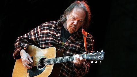 Folk & Bluegrass: Neil Young Flies Solo